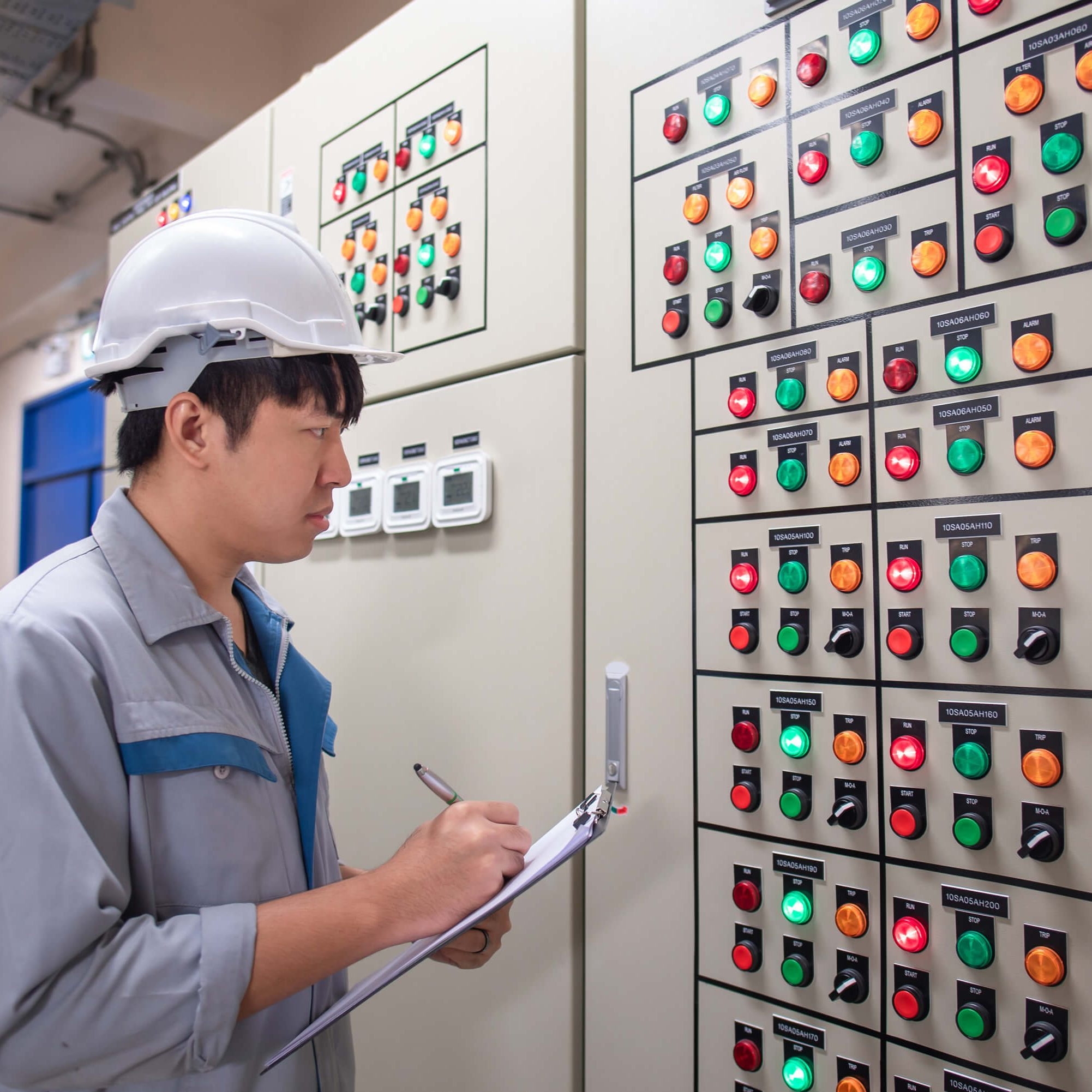 stock-photo-engineer-working-and-check-status-electrical-panel-at-hvac-room-1100341892